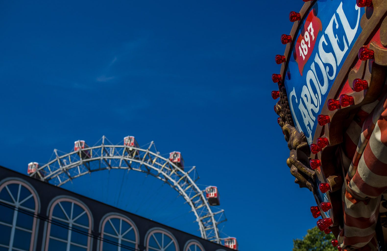 The Ferris Wheel and a Merry-Go-Round at the Prater in Vienna