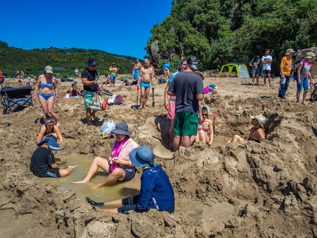 Busy pools at Hot Water Beach on the North Island of New Zealand