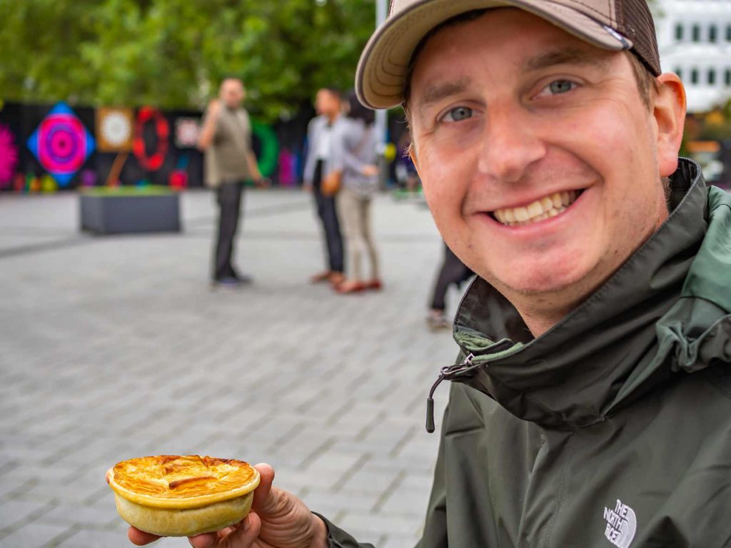 Eating a minced meat pie in New Zealand
