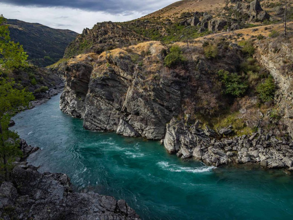 The Kawarau River is a beautiful blue river that snakes through Otago in New Zealand. The river provides beautiful scenery and some great opportunities to take pictures of New Zealand.
