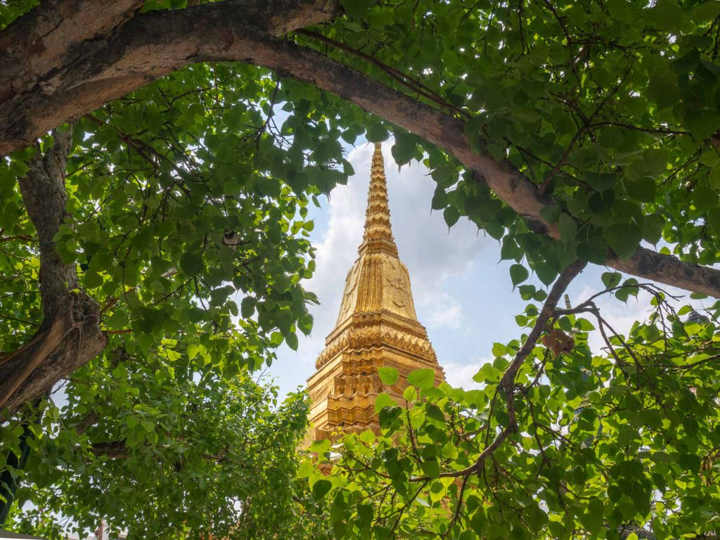 A golden pagoda at The Grand Palace, one of the the top Bangkok attractions.