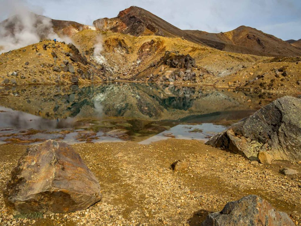 At the top of the Tongariro Alpine Crossing: our favorite New Zealand North Island Hike