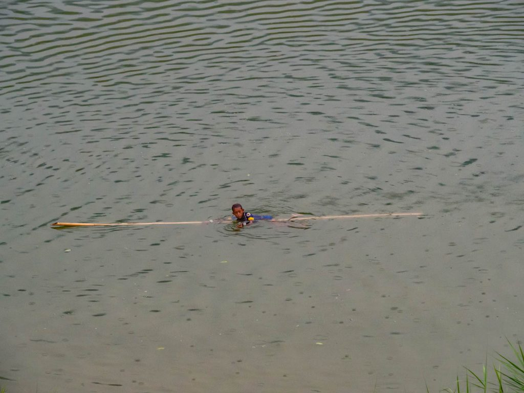 Boy swimming in Nam Ou river