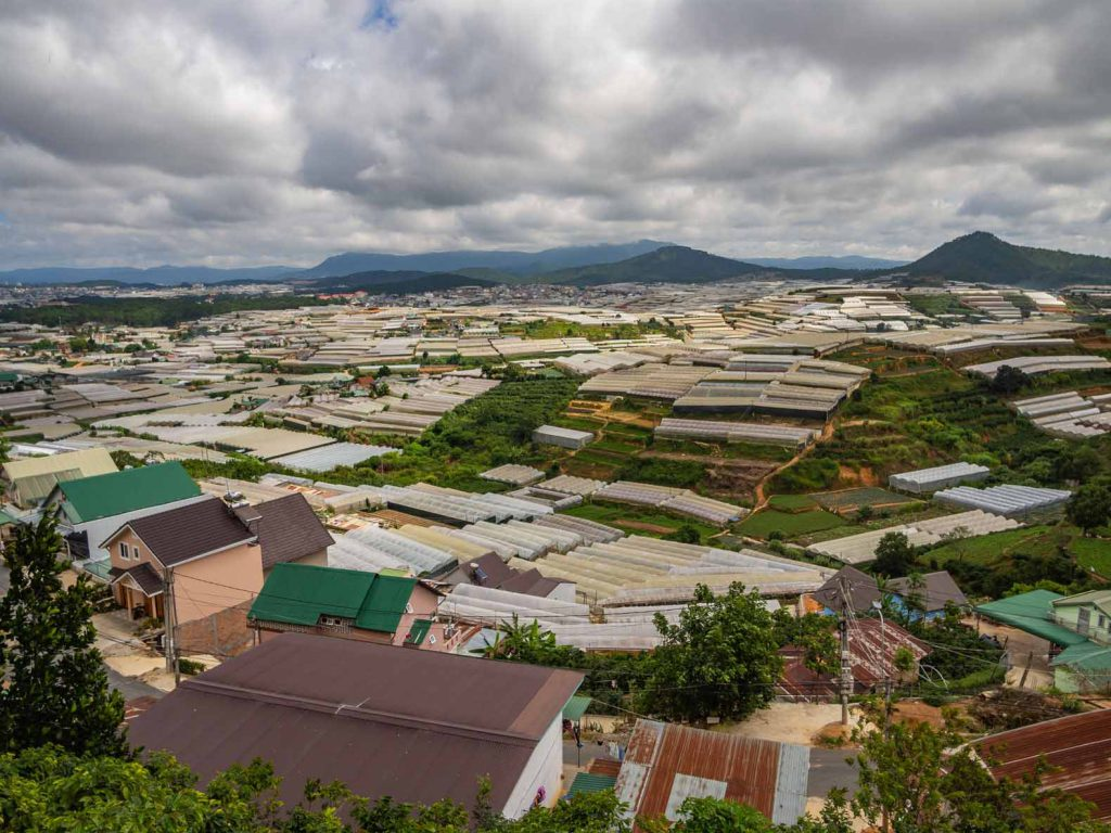 View over the flower greenhouses of Dalat on our Easy rider tour