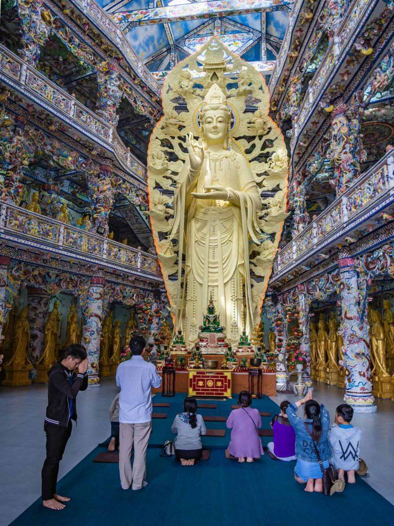 Large golden statue inside Linh Phuoc Pagoda near Dalat, Vietnam