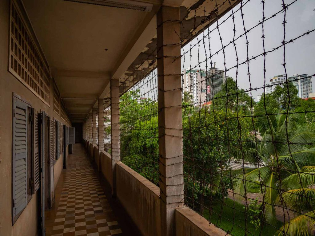 A barbed wired corridor at Tuol Sleng Genocide Museum