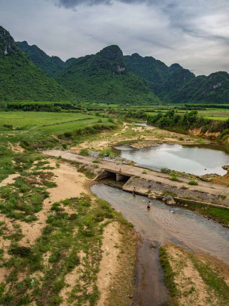 Children playing in the river at Phong Nha