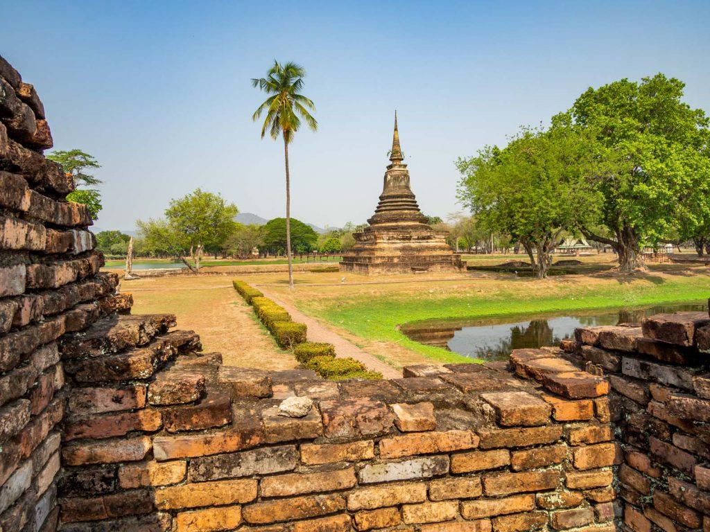 Brick wall and stupa at the Sukhothai historical park