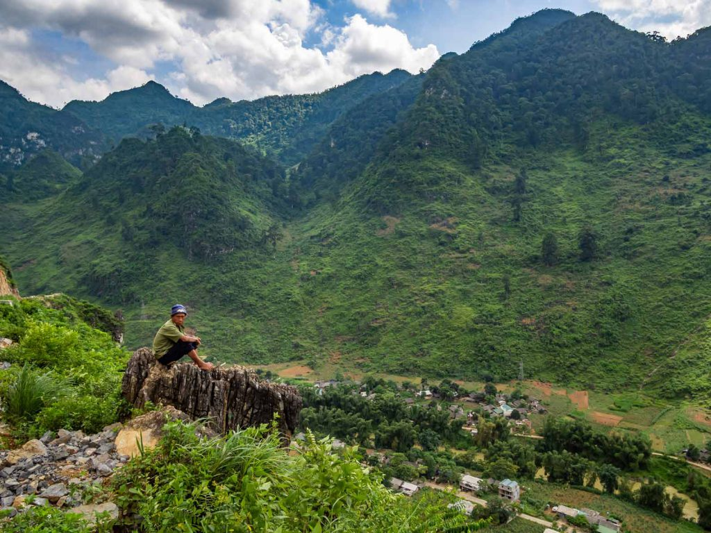 A Vietnamese local overlooking the valley and the Son Lo river in Northern Vietnam