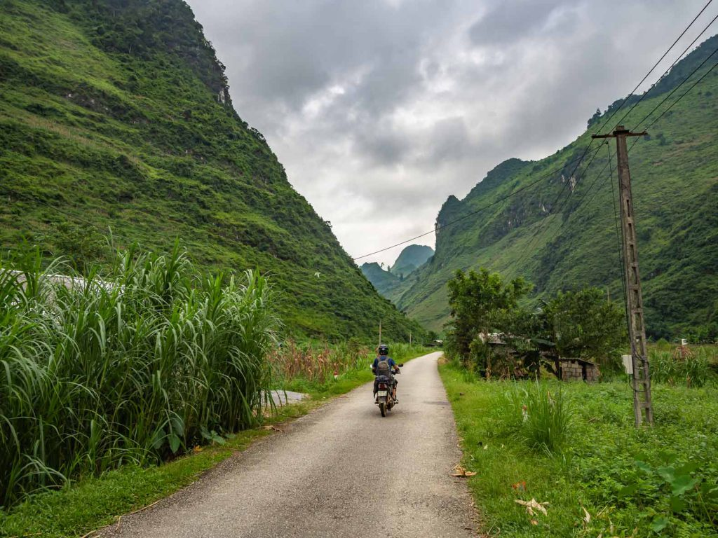 Driving through the valley during the Ha Giang Loop