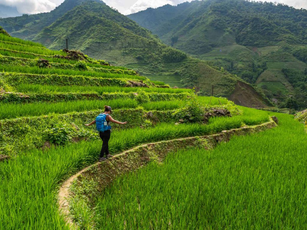 Walking through the rice fields during our Sapa trekking