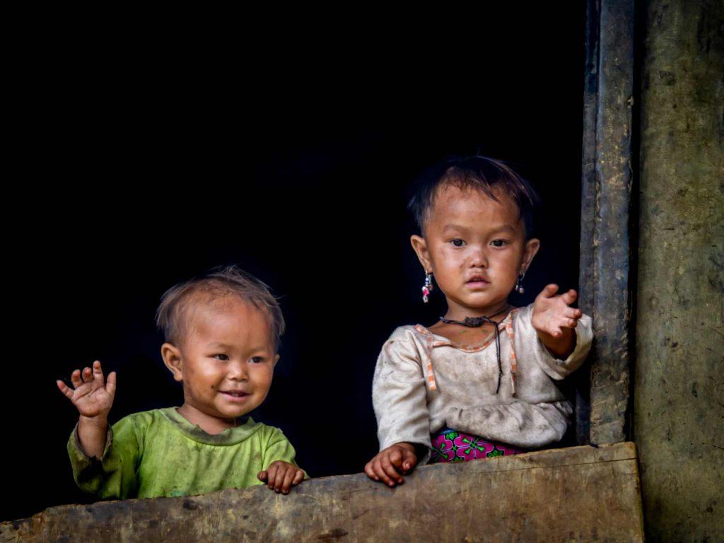 Vietnamese children waving at the camera