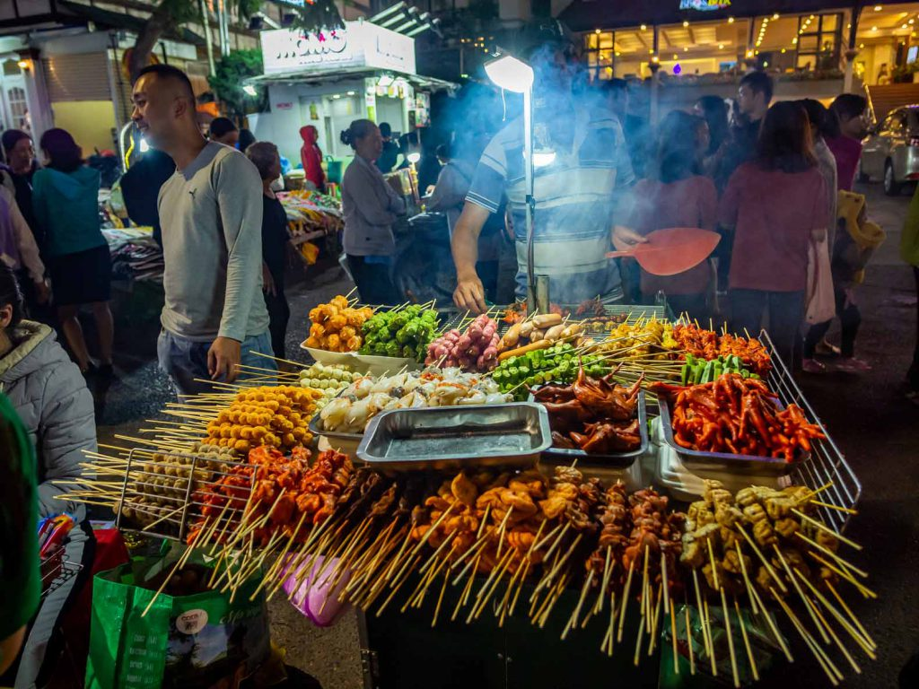 Street vendor with all types of meat on a stick in Dalat, Vietnam