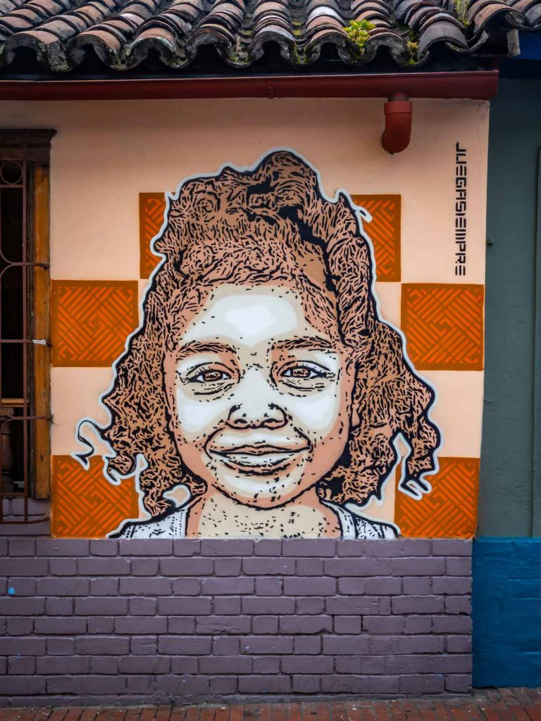 Graffiti in Bogota (Colombia), stencil image of a girl