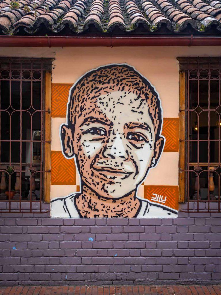 Street art in Bogota (Colombia), stencil image of a boy