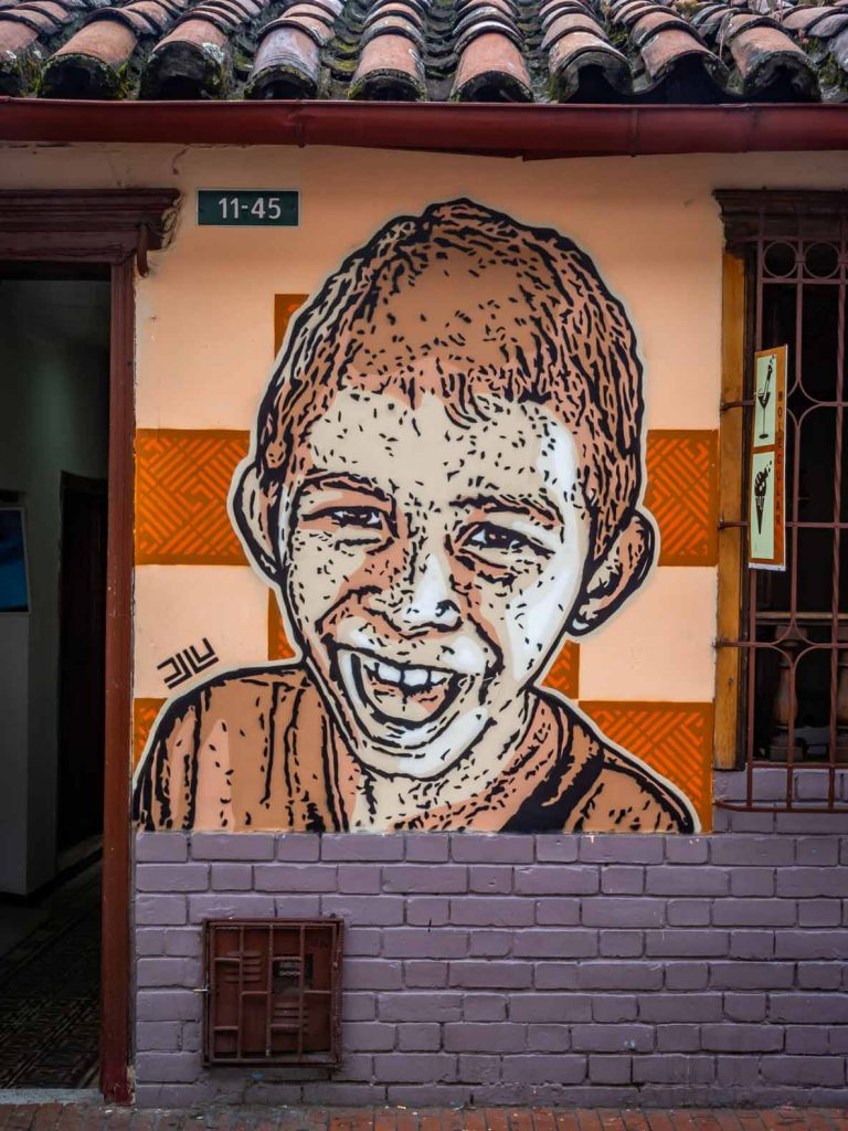 Urban art in Bogota (Colombia), stencil image of a boy