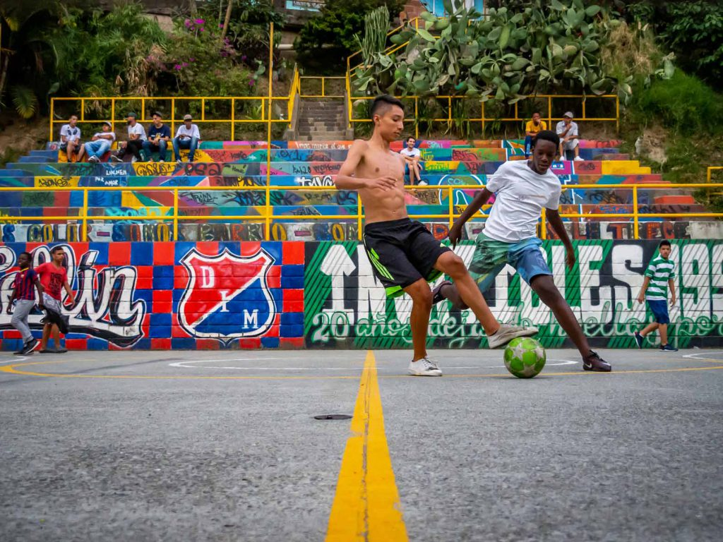 Teenagers playing soccer on a soccer field in Comuna 13 in Medellin, Colombia
